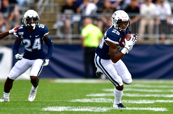 9/7/2019 Mike Orazzi | StaffrUConn's Tyler Coyle (25) with an interception and TD during Saturday's football game with the University of Illinois at Rentschler Field in East Hartford.r