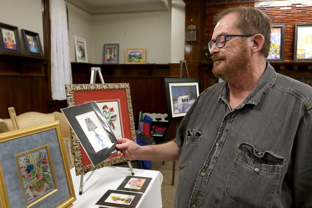 . Artist Kevin McCarthy, 62, of Fitchburg had an art show of some of his work this week at the Fitchburg Senior Center. McCarthy talks about one of his his pieces at the show on Wednesday afternoon. SENTINEL & ENTERPRISE/JOHN LOVE