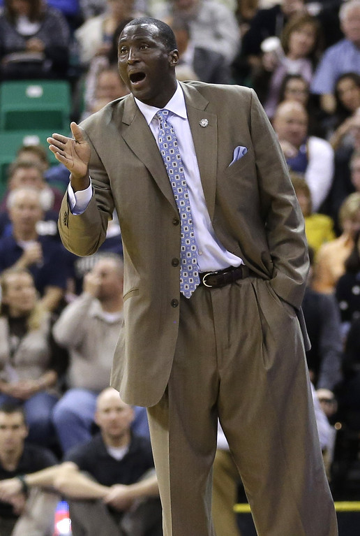 . Utah Jazz head coach Tyrone Corbin shouts to his team in the first quarter during an NBA basketball game against the Denver Nuggets Monday, Nov. 11, 2013, in Salt Lake City.  (AP Photo/Rick Bowmer)
