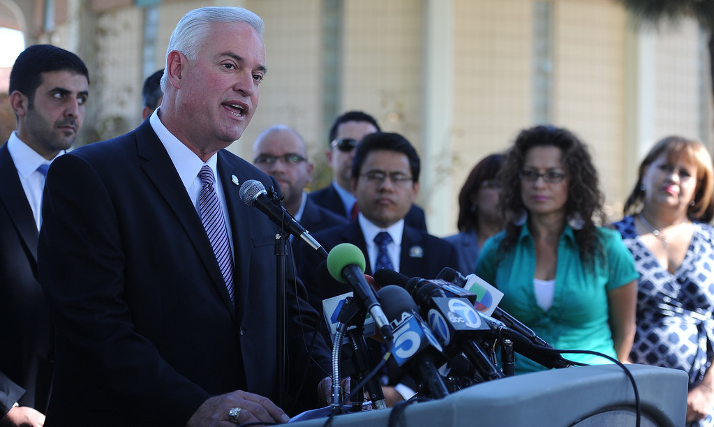 . City of Downey mayor , DN. Mario A. Guerra flanked by many elected officials speaks during a press conference calling for Senator Ron Calderon to resign his position in the California State Senate in front of the Bell Gardens City Hall in Bell Gardens , Calif., on Wednesday, Nov. 13, 2013.   (Keith Birmingham Pasadena Star-News)