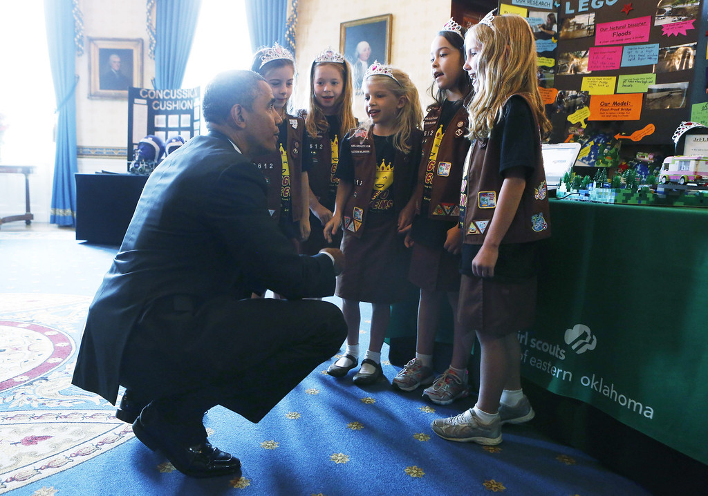 ". U.S. President Barack Obama (L) speaks with Avery Dodson, Natalie Hurley, Miriam Schaffer, Claire Winton and Lucy Claire Sharp, winners of the Junior FIRST Lego League Challenge, with the ""Flood-proof\"" bridge design project during the  2014 White House Science Fair at the White House May 27, 2014 in Washington, DC. Obama hosted the science fair to announce new steps as part of his Educate to Innovate campaign, and celebrated student winners of a range of science, technology, engineering and math (STEM) competitions from across the country.  (Photo by Aude Guerruccip-Pool/Getty Images)"