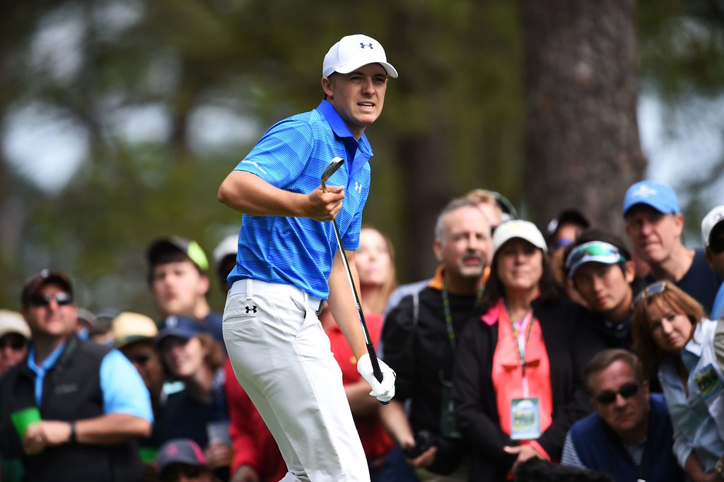 . US golfer Jordan Spieth reacts after teeing off on the 4th hole during Round 4 of the 80th Masters Golf Tournament at the Augusta National Golf Club on April 10, 2016, in Augusta, Georgia. / AFP PHOTO / Jim WatsonJIM WATSON/AFP/Getty Images