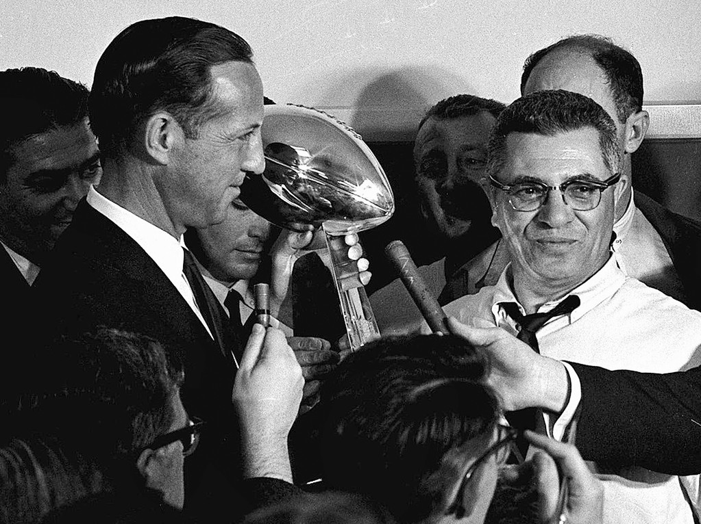 . ** FILE ** In this Jan. 15, 1967 file photo, football commissioner Pete Rozelle, left, presents the trophy to Green Bay Packers coach Vince Lombardi after they beat the Kansas City Chiefs in the Super Bowl in Los Angeles. The Pittsburgh Steelers face the Arizona Cardinals in the upcoming Super Bowl XLIII in Tampa, Fla. (AP Photo, File)