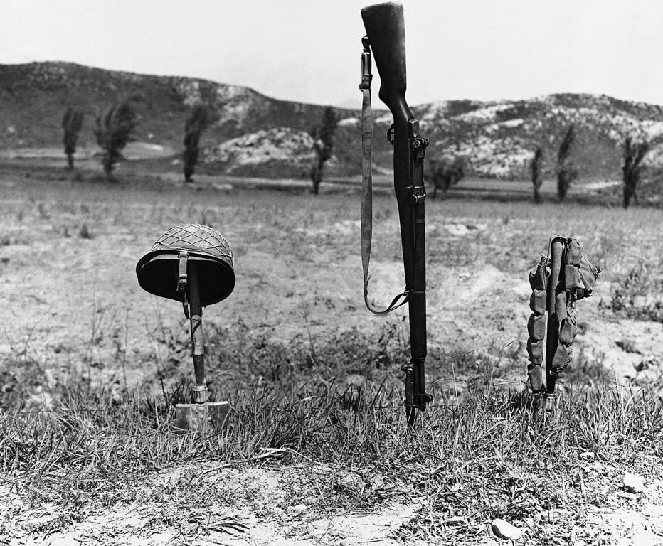 . His Helmet, rifle and ammunition belt mark spot where an unidentified U.S. soldier was killed in battle on the Korean front on June 24, 1951. (AP Photo)
