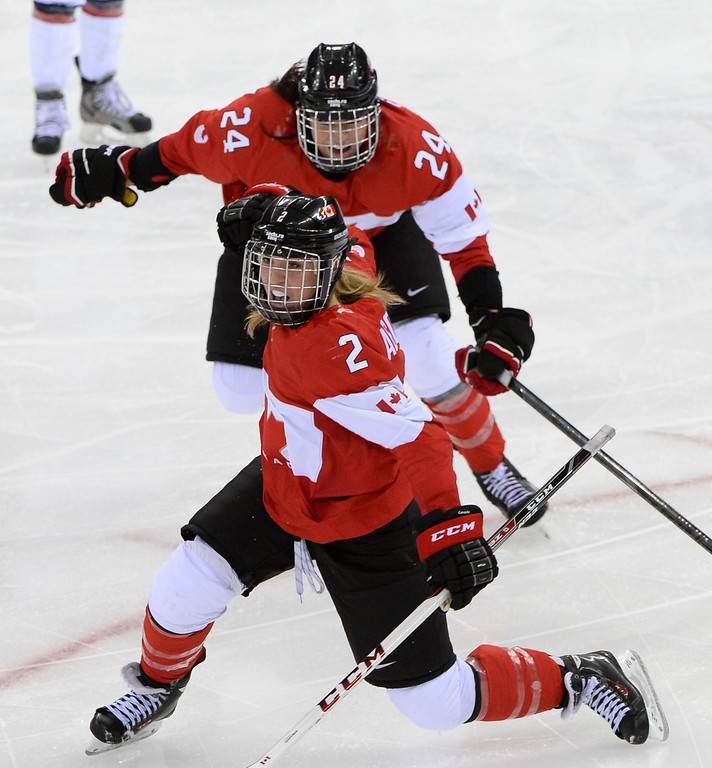 . Canada\'s Meghan Agosta-Marciano celebrates after scoring a goal during the Women\'s Ice Hockey Group A match between Canada and USA at the Sochi Winter Olympics on February 12, 2014 at the Shayba Arena. AFP PHOTO / JONATHAN NACKSTRAND/AFP/Getty Images