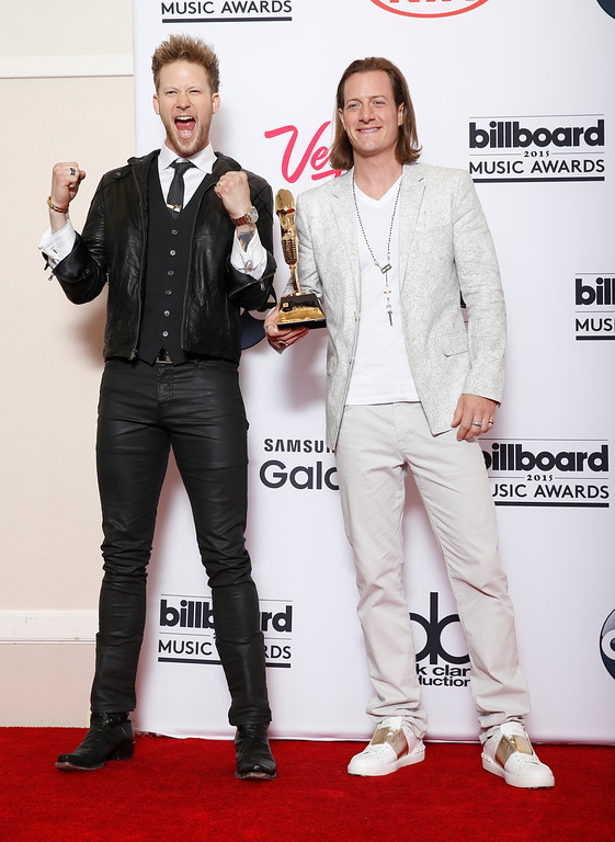 . Brian Kelley, left, and Tyler Hubbard of Florida Georgia Line pose in the press room with the award for top country artist at the Billboard Music Awards at the MGM Grand Garden Arena on Sunday, May 17, 2015, in Las Vegas. (Photo by Eric Jamison/Invision/AP)