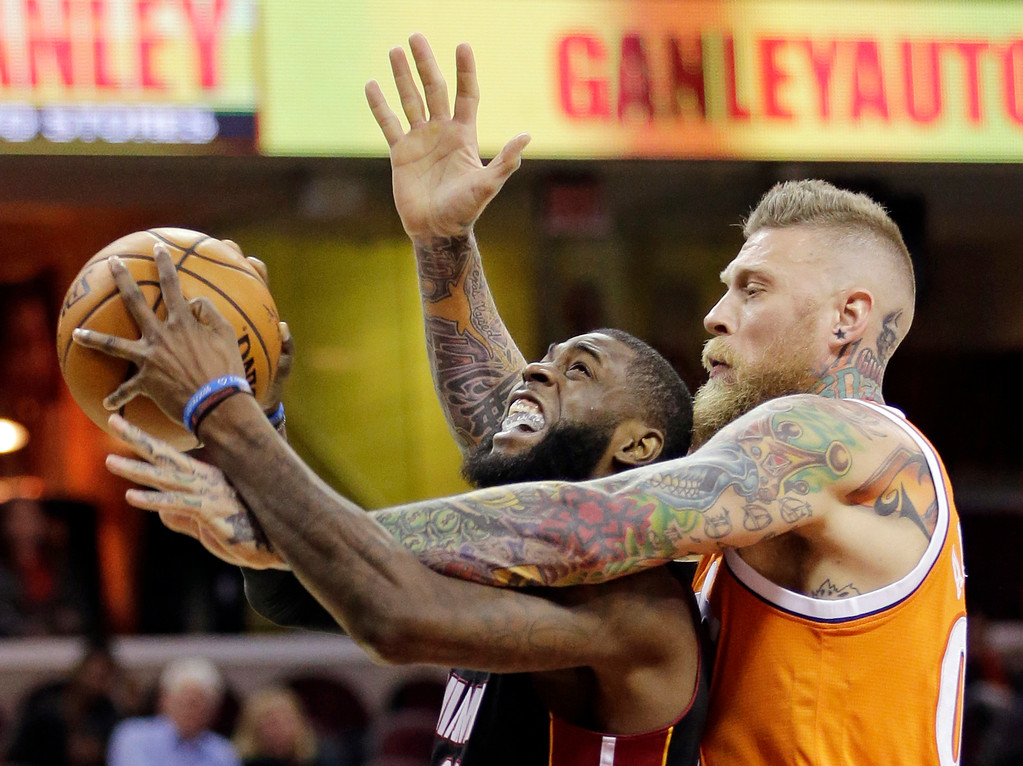 . Miami Heat\'s Willie Reed, left, is fouled by Cleveland Cavaliers\' Chris Andersen in the second half of an NBA basketball game Friday, Dec. 9, 2016, in Cleveland. (AP Photo/Tony Dejak)