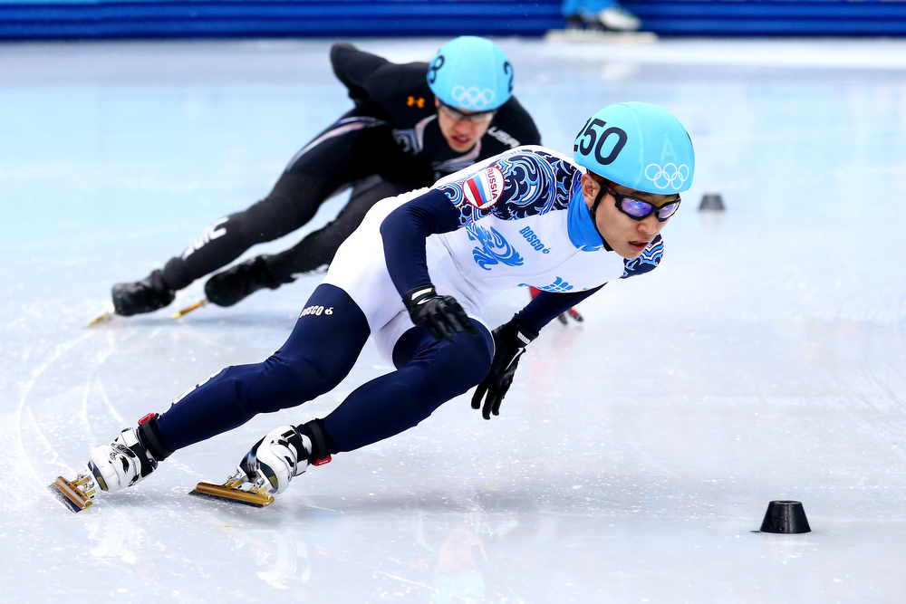 . Victor An of Russia and J.R Celski of the Unitesd States compete in the Short Track Men\'s 5000m Relay Final A on day fourteen of the 2014 Sochi Winter Olympics at Iceberg Skating Palace on February 21, 2014 in Sochi, Russia.  (Photo by Ryan Pierse/Getty Images)