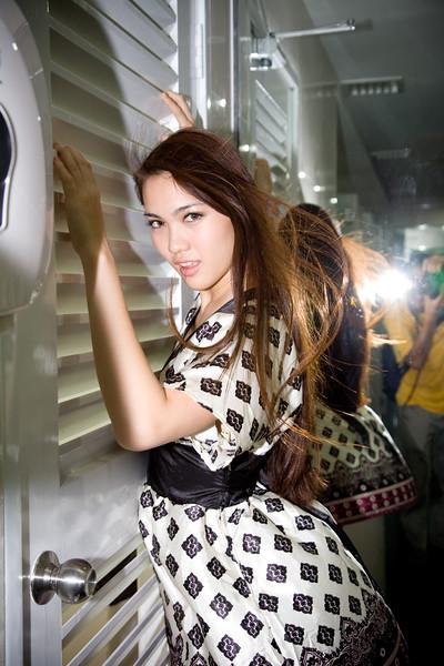 asian young women wind blowing her long brunette hair