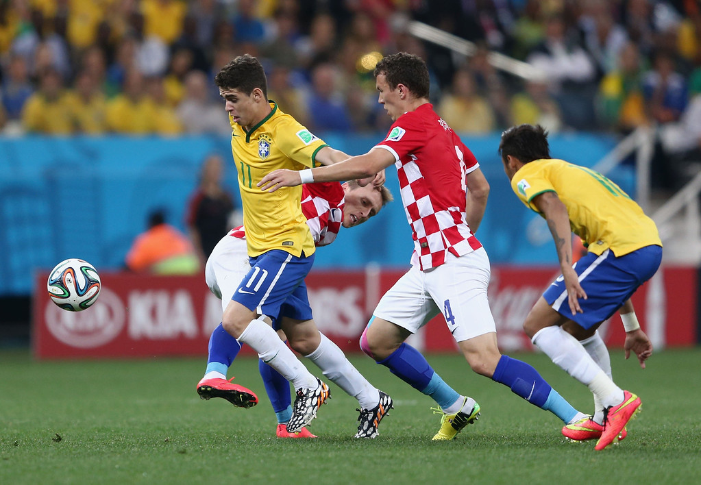 . Oscar of Brazil controls the ball against Ivan Perisic of Croatia during the 2014 FIFA World Cup Brazil Group A match between Brazil and Croatia at Arena de Sao Paulo on June 12, 2014 in Sao Paulo, Brazil.  (Photo by Warren Little/Getty Images)