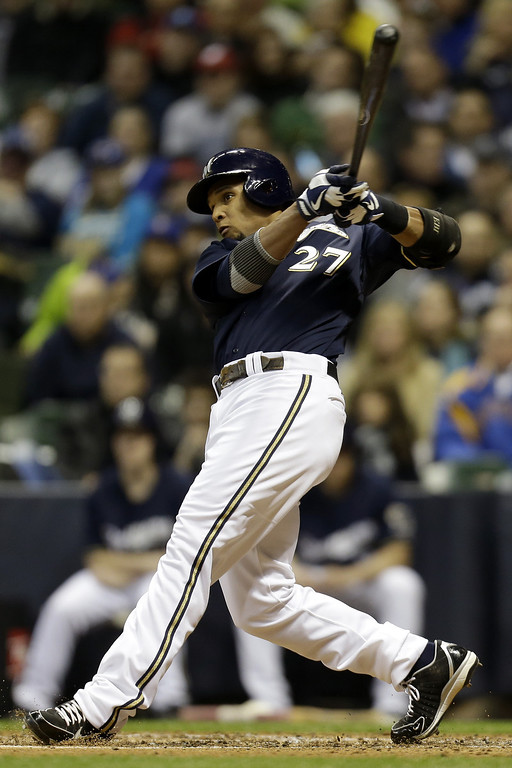 . MILWAUKEE, WI - APRIL 2: Carlos Gomez #27 of the Milwaukee Brewers doubles off this pitch scoring Aramis Ramirez in the bottom of the second inning against the Colorado Rockies at Miller Park on April 2, 2013 in Milwaukee, Wisconsin. (Photo by Mike McGinnis/Getty Images)