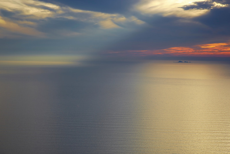 A beam of light shines apon the sea as the Farallon Islands are lit by more shimmering light.  This is a view from the top of Mt. Tamalpais at 2100 ft (700m) above sea level.