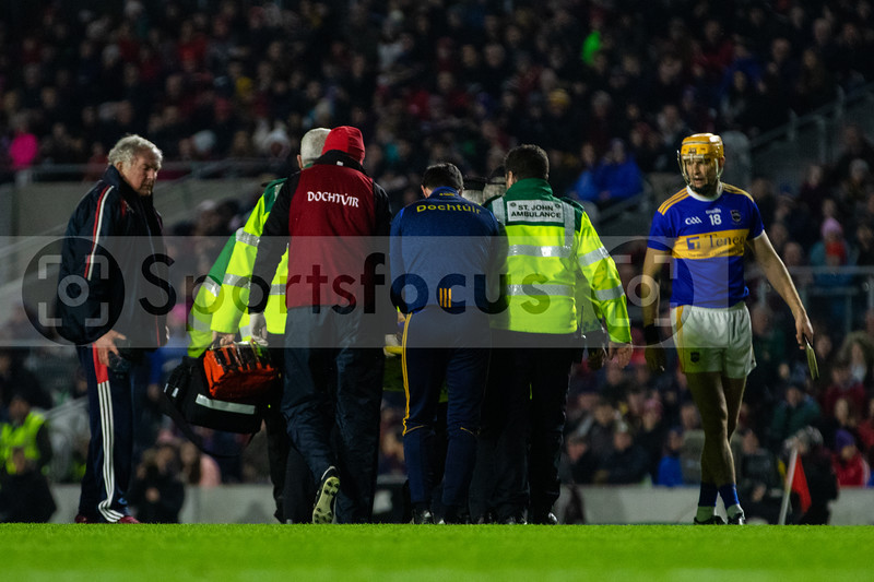 Tipperary's John O'Dwyer is etretchered off the field
