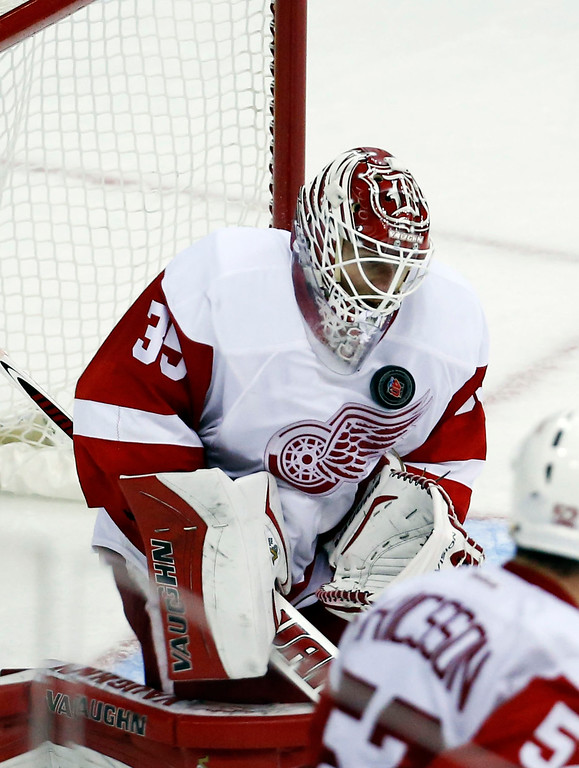 . Detroit Red Wings goalie Jimmy Howard (35) blocks a shot in the third period of an NHL hockey game against the Washington Capitals, Wednesday, Oct. 29, 2014, in Washington. The Red Wings won 4-2. (AP Photo/Alex Brandon)