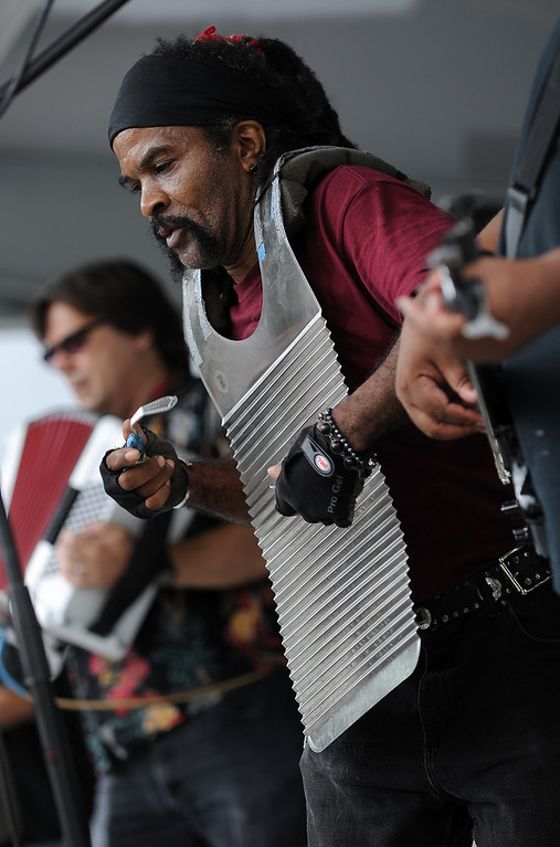 ". Perez ""Butch\"" Morris plays the frottoir with Moster Guillaume & Zydeco Hep Cats at Arts Beats & Eats. (Daily Tribune/DAVID DALTON)"