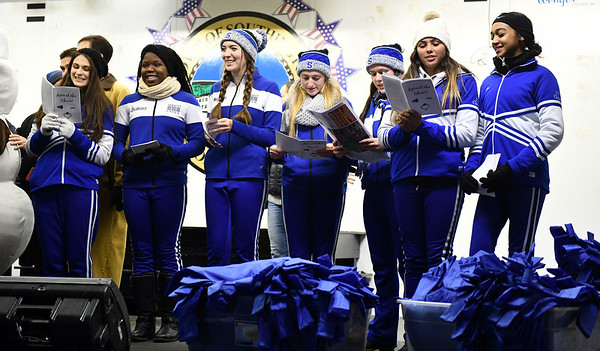 12/6/2019 Mike Orazzi | StaffrSome Southington High School Cheerleaders sing Christmas carols during Southington's White Christmas in the Community on the town green on Friday evening.