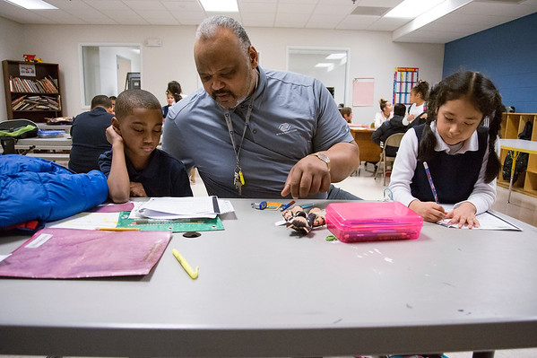 02/18/20 Wesley Bunnell | StaffrrAllan Maddox, age 6, receives help from Berwyn Kelley, the Senior Program Director of the New Britain Boys and Girls Club during a home work club session on Tuesday afternoon as MariaJose Morales, R, works on her math homework.