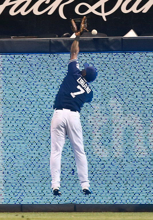 . San Diego Padres right fielder Rymer Liriano can not make the catch on a home run hit by Colorado Rockies\' Drew Stubbs in the eighth inning of a baseball game Tuesday, Sept. 23, 2014, in San Diego.  (AP Photo/Lenny Ignelzi)