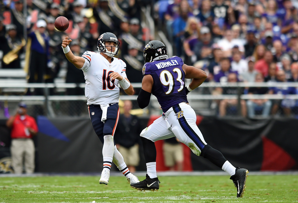 . Chicago Bears quarterback Mitchell Trubisky, left, throws to a receiver as he is pressured by Baltimore Ravens defensive end Chris Wormley in the second half of an NFL football game, Sunday, Oct. 15, 2017, in Baltimore. (AP Photo/Gail Burton)