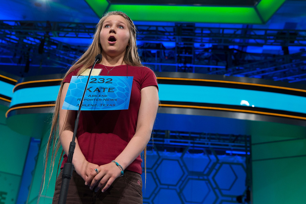 ". Kate Miller of Abilene, Texas, reacts after learning she spelled the word ""brachypterous\"" correctly during the semifinal round of the National Spelling Bee, on Thursday, May 29, 2014, in Oxon Hill, Md. (AP Photo/ Evan Vucci)"