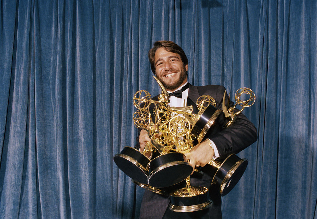 """. Actor Tony Danza poses with some of the Emmys he collected as the \""""designated acceptor\"""" for winners not able to attend the 40th annual Emmy awards on Aug. 20,1988 in Pasadena. (AP Photo/Lennox Mclendon)"""