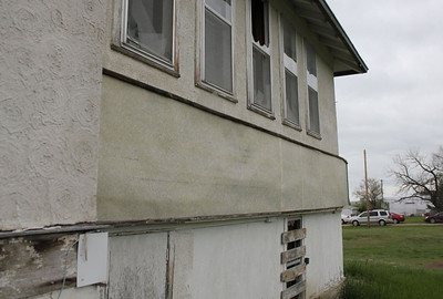 Basement windows boarded up for security.