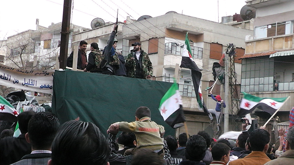 . Members of the Free Syrian Army (FSA) and their supporters gather in the Khalidiya neighborhood of the flashpoint city of Homs on January 13, 2012 as thousands protested in support of the rebels throughout the country. The rallies came after the largest civilian opposition group decided to boost cooperation with the rebel armed group, formed from deserters from the regular army who mutinied over the regime\'s deadly crackdown. The FSA says it has some 40,000 fighters under its command. -/AFP/Getty Images