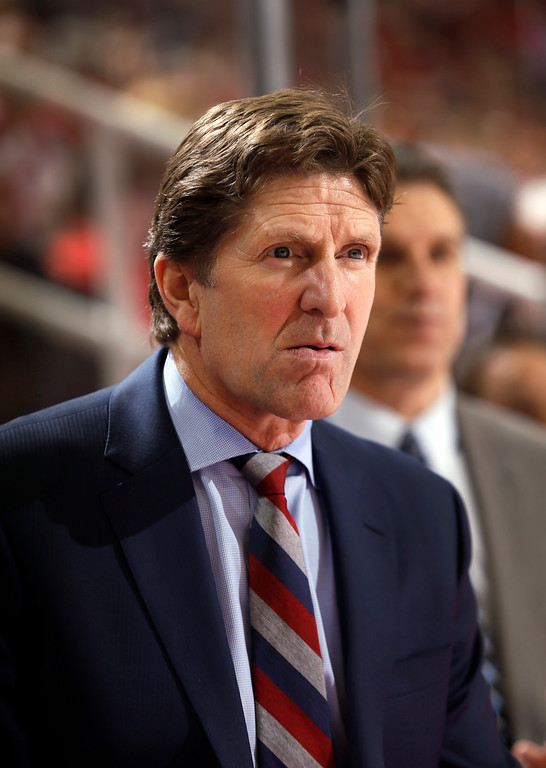 . Detroit Red Wings head coach Mike Babcock watches the second period of an NHL hockey game against the New Jersey Devils in Detroit, Friday, Nov. 7, 2014. (AP Photo/Paul Sancya)