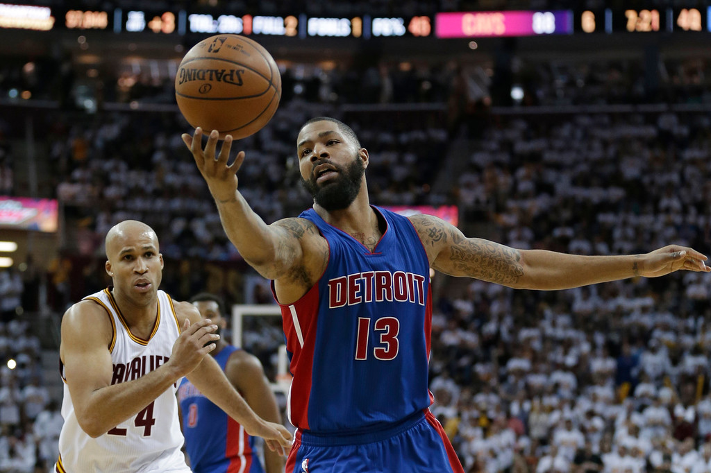 . Detroit Pistons\' Marcus Morris (13) grabs a pass against Cleveland Cavaliers\' Richard Jefferson (24) in the second half in Game 1 of a first-round NBA basketball playoff series, Sunday, April 17, 2016, in Cleveland. The Cavaliers won 106-101. (AP Photo/Tony Dejak)
