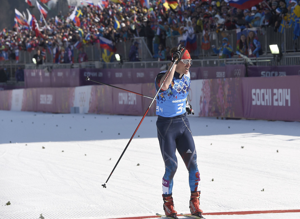 . Russia\'s Maxim Vylegzhanin crosses the finish line to win with his team the silver medal in the Men\'s Cross-Country Skiing 4 x 10km Relay at the Laura Cross-Country Ski and Biathlon Center during the Sochi Winter Olympics on February 16, 2014 in Rosa Khutor near Sochi. ODD ANDERSEN/AFP/Getty Images