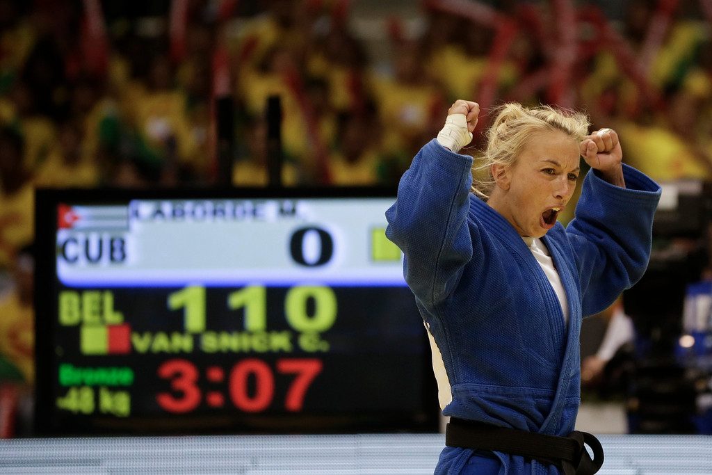 . Charline Van Snick, from Belgium, celebrates defeating Maria Celia Laborde, from Cuba, after their women\'s -48kg bronze medal match at the World Judo Championships in Rio de Janeiro, Brazil, Monday, Aug. 26, 2013. (AP Photo/Felipe Dana)
