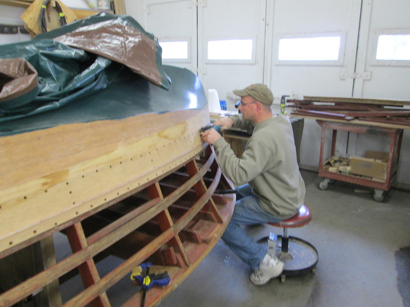 Removing the second plank down on the port side.