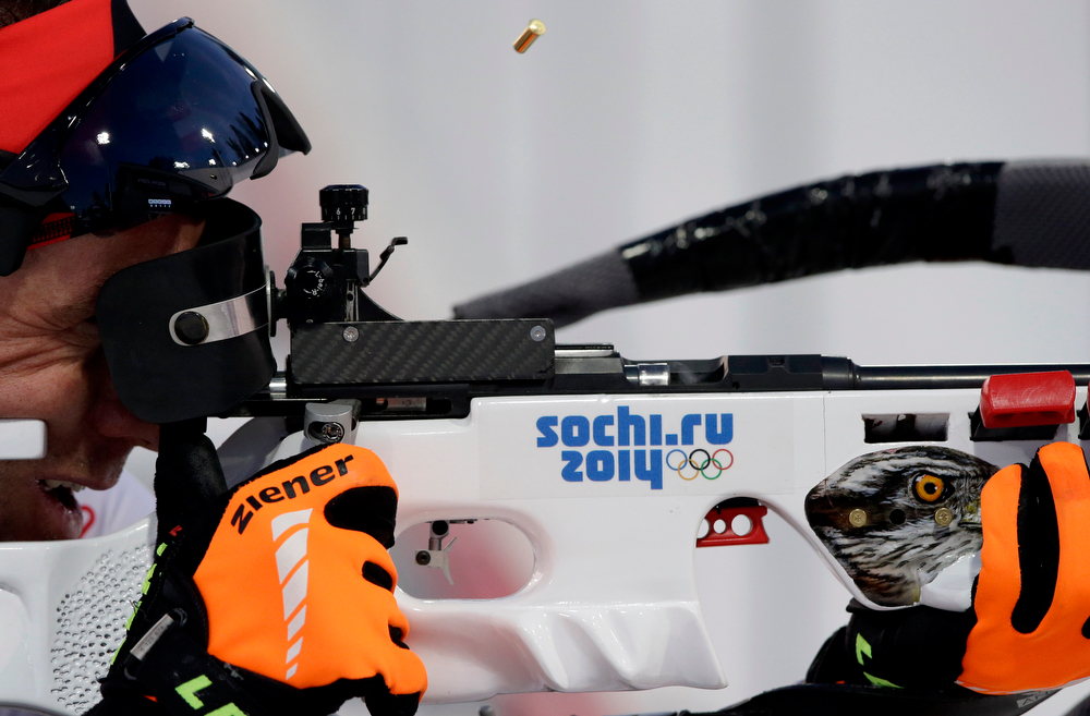 . Austria\'s Christoph Sumann shoots during the men\'s biathlon 20k individual race, at the 2014 Winter Olympics, Thursday, Feb. 13, 2014, in Krasnaya Polyana, Russia. (AP Photo/Lee Jin-man)
