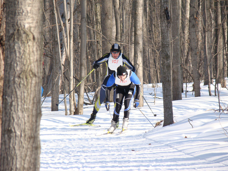 After the first couple kilometers, Yvon Dufour remains in the lead, but Cliff Onthank has worked his way up from fifth to second, and is hell bent on getting into the lead.