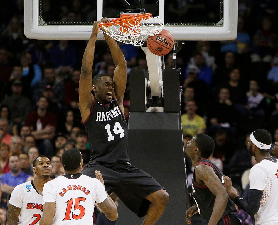 . Harvard\'s Steve Moundou-Missi (14) dunks against Cincinnati in the second half during the second-round of the NCAA men\'s college basketball tournament in Spokane, Wash., Thursday, March 20, 2014. (AP Photo/Young Kwak)