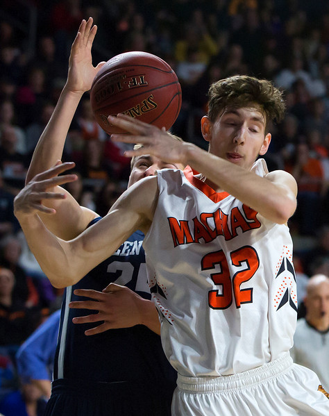 BANGOR, Maine -- 03/04/2017 -- Greenville's Connor DiAngelo (left) battles for rebound against Machias' Mark Anthony during their Class D boys basketball state championship at the Cross Insurance Center in Bangor Saturday. Ashley L. Conti   BDN