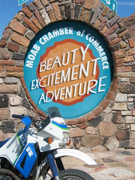 KLR 650 at Moab sign