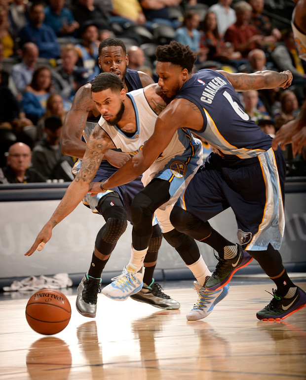 . DENVER, CO - FEBRUARY 29: Denver Nuggets guard D.J. Augustin (12) runs into Memphis Grizzlies guard Mario Chalmers (6) as he dribbles past half court February 29, 2016 at Pepsi Center. (Photo By John Leyba/The Denver Post)