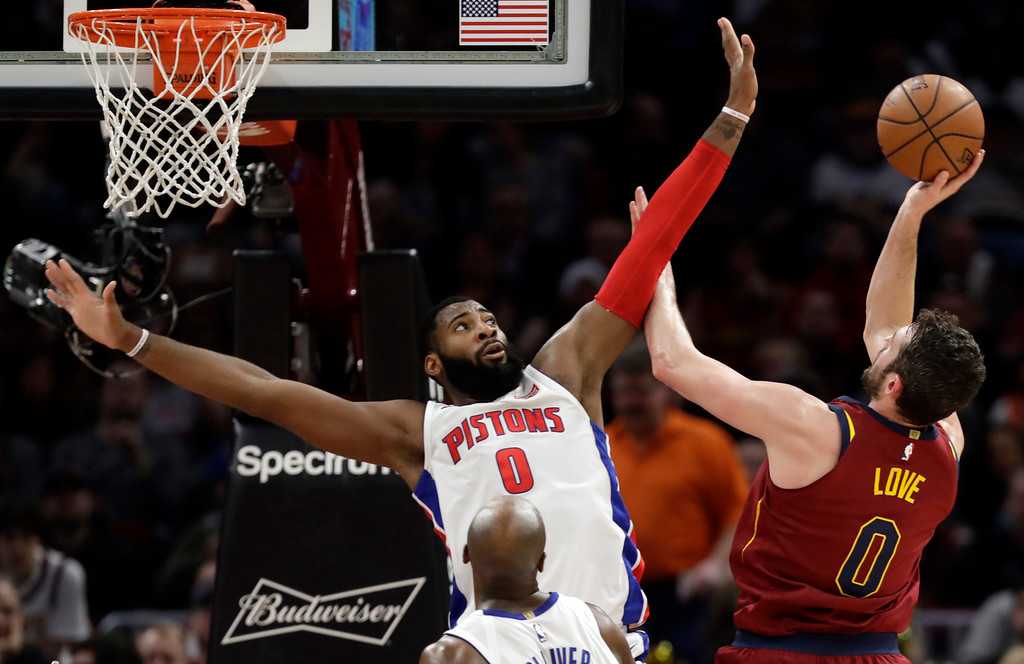 . Cleveland Cavaliers\' Kevin Love, right, drives to the basket against Detroit Pistons\' Andre Drummond in the second half of an NBA basketball game, Sunday, Jan. 28, 2018, in Cleveland. (AP Photo/Tony Dejak)