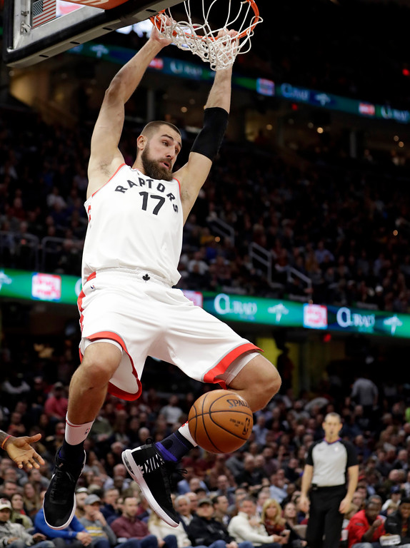 . Toronto Raptors\' Jonas Valanciunas dunks during the first half of the team\'s NBA basketball game against the Cleveland Cavaliers, Wednesday, March 21, 2018, in Cleveland. (AP Photo/Tony Dejak)