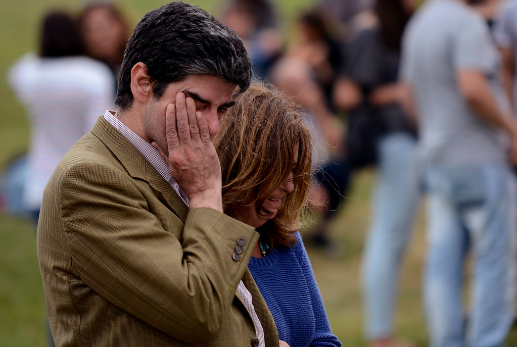 . Relatives of victims involved in a train accident wait for news at a victims information point in Santiago de Compostela, Spain, Thursday, July 25, 2013.  (AP Photo/Brais Lorenzo)