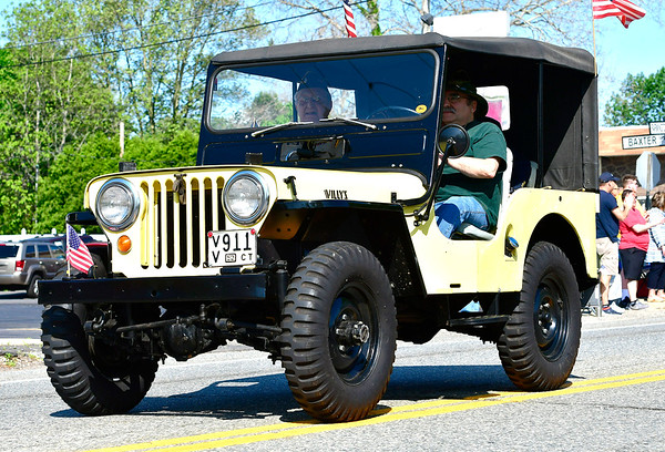 5/25/2019 Mike Orazzi | Staff Al Gregory rides in Eric Weiss' 1952 Jeep Willys during the Berlin Memorial Day Parade on Saturday along Farmington Avenue.