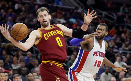 . Cleveland Cavaliers forward Kevin Love (0) tries controlling the ball next to Detroit Pistons forward Greg Monroe (10) during the second half of an NBA basketball game, Tuesday, Feb. 24, 2015 in Auburn Hills, Mich. Cleveland defeated the Pistons 102-93. (AP Photo/Carlos Osorio)