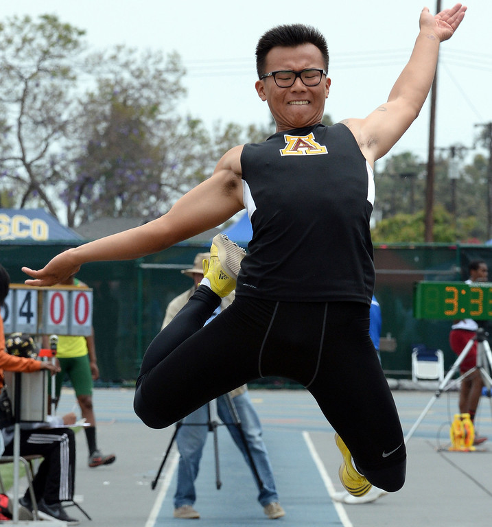 . Arcadia\'s Sung Shin Cho competes in the division 1 long jump during the CIF Southern Section track and final Championships at Cerritos College in Norwalk, Calif., Saturday, May 24, 2014.   (Keith Birmingham/Pasadena Star-News)