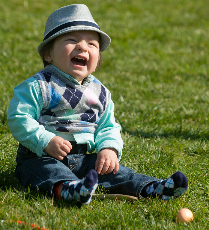 . A young boy plays with an egg and spoon prior to participating in an egg roll race during the White House Easter Egg Roll on the South Lawn of the White House in Washington, DC, April 1, 2013. US President Barack Obama hosts the annual event, featuring live music, sports courts, cooking stations, storytelling and Easter egg rolling. AFP PHOTO / Saul LOEB/AFP/Getty Images