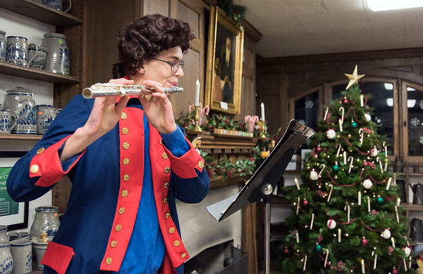 11/30/18 Wesley Bunnell | Staff The Berlin Historical Society is holding their annual craft fair Friday 11/30 and Saturday 12/1 at their museum at 305 Main St with the theme of a child's Christmas in Berlin. Berlin High School 10th grader Clemens Henning plays the flute for visitors.