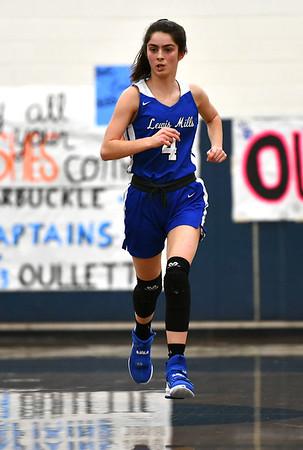 2/13/2020 Mike Orazzi | StaffrLewis Mills' Lauren Alvarez (4) during Thursday night's girls basketball game in Bristol.