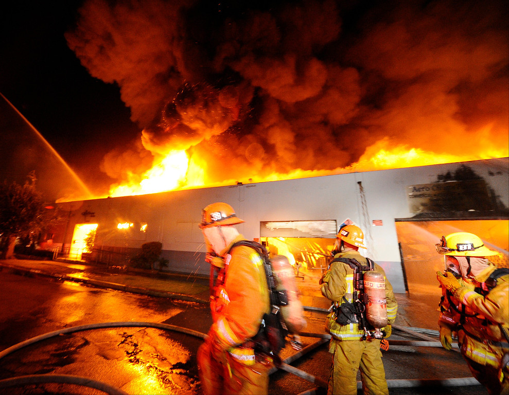 . LA city firefighters battle heavy flames of a grater alarm fire at 14660 Arminta St. early this morning. It took 162 firefighters 2 hrs to extinguish the blaze that destroyed the Aero Chrome Plating building. Van Nuys CA. Aug 21,2013 Photo by Gene Blevins/LA Daily News