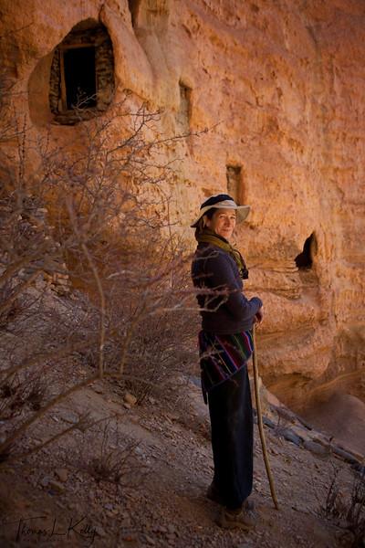 Carroll Dunham infront of caves above Drakmar. Mustang, Nepal.