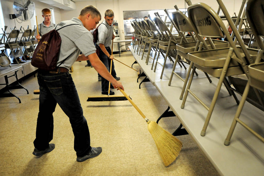 . After a lunch break, Kolton Wahl, front, and Levi Anderson sweep the lunchroom floor. (Pioneer Press: Jean Pieri)